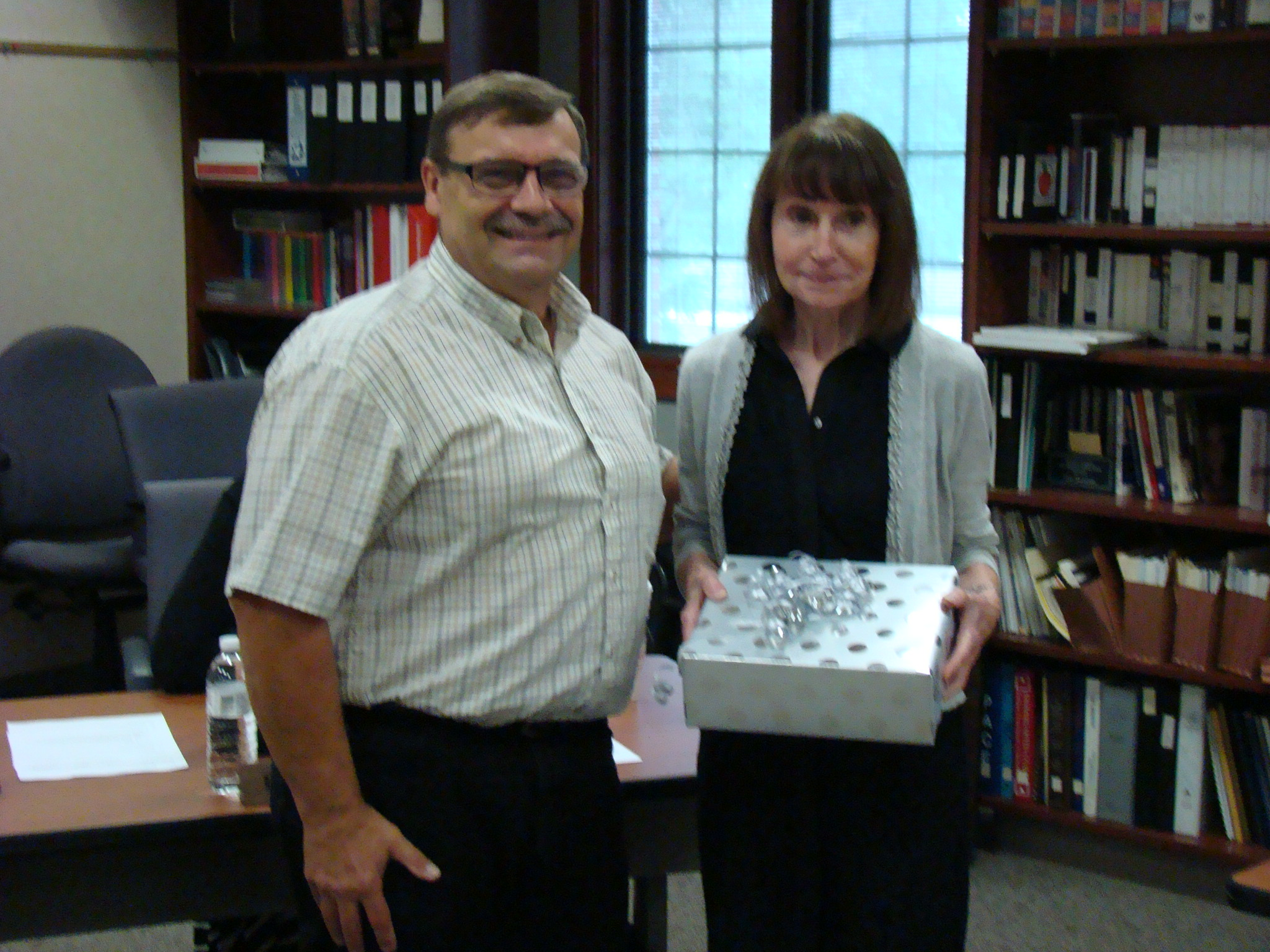 middlebury community schools archived happy retirement photograph of shirley meyer accepting her retirement gift from school board member david black