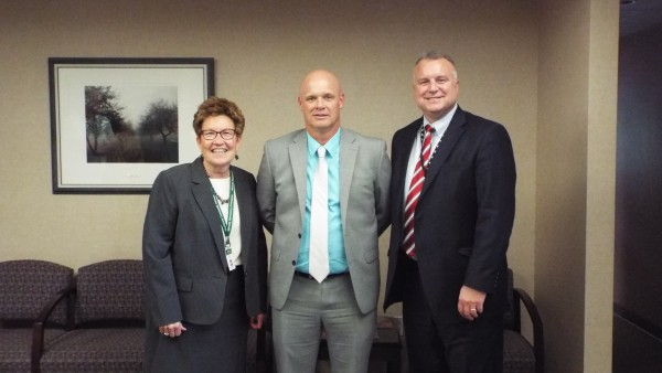 Left to Right: MCS Superintendant, Jane Allen; NHS Basketball Coach, Scott Radeker; and NHS Principal, Drew Wood